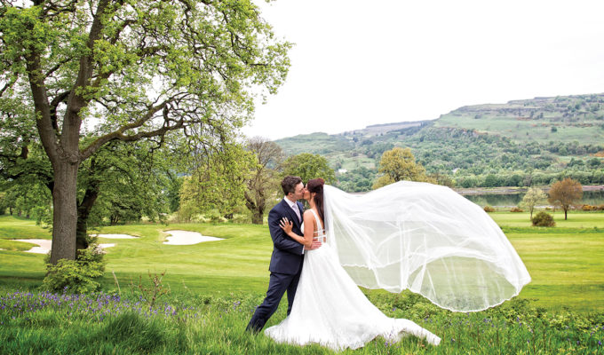bride and groom in hotel grounds