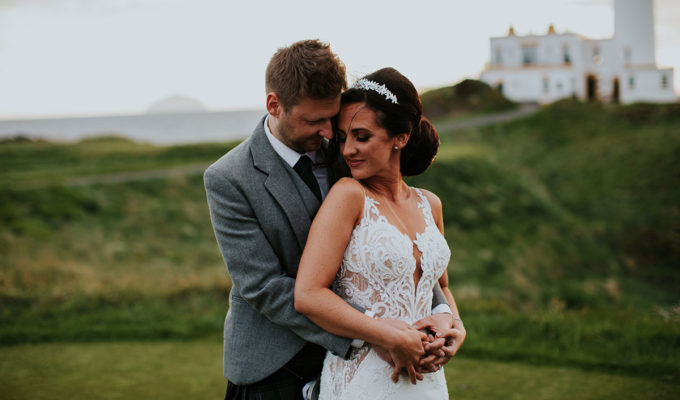 bride-and-groom-in-front-of-turnberry-lighthouse