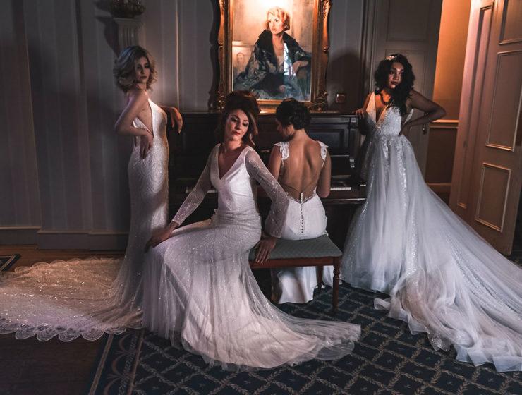 four-bridal-models-wearing-wedding-dresses-posing-at-piano