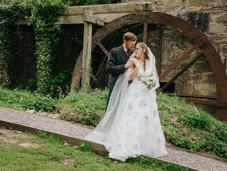 bride-and-groom-in-front-of-old-mill